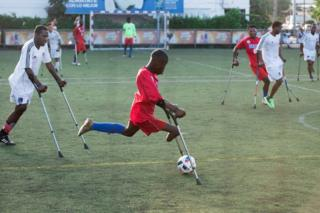 in_pictures A football player from the Haiti team and survivor of the 2010 earthquake, in action during the