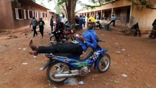 A Malian man rests on a motorcycle at a polling station in Bamako, Mali - 29 July 2018