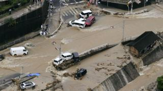Roads are covered in mud waters after a landslide caused by heavy rains in Aki, Hiroshima prefecture
