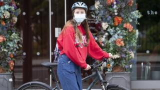 Cyclist wearing mask