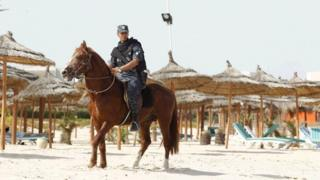 Tourist police officers patrol the beach in Hammamet, Tunisia, Jun18
