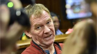 Danish man living in South Africa Peter Frederiksen sits in the accused dock ahead of his bail application at the Bloemfontein Magistrate's court on November 4, 2015.