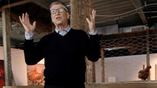 Billionaire philanthropist and Microsoft's co-founder Bill Gates speaks to the media in front of a chicken coop in New York