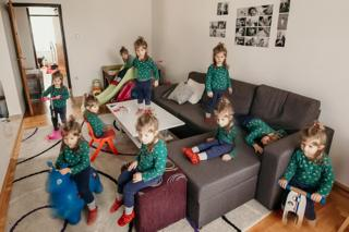 A multiple exposure image of the same child doing different activities at home