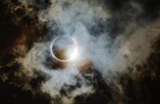 Eclipse with clouds in the sky
