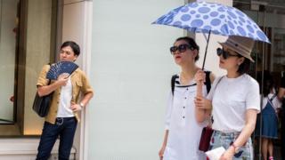 Tokyo residents braving the heat