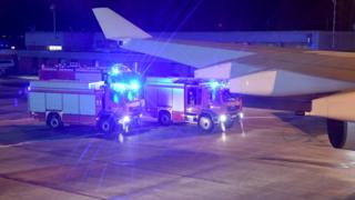 Fire engines are seen from the inside of the plane Konrad Adenauer in Cologne, Germany, 29 November 2018