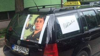 A Sarajevo taxi displays a picture of Robert De Niro