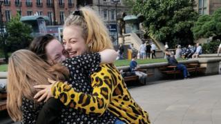 Spearmint Rhino dancers celebrate outside Sheffield Town Hall