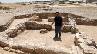 A worker from Israel's Antiquities Authority at the site of an ancient mosque
