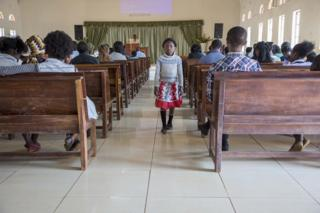 in_pictures A girl attends a Baptist church service