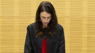 Prime Minister Jacinda Ardern observes a minute's silence during her cabinet meeting
