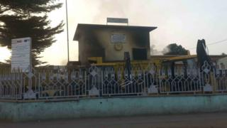 Smoke rises near the compound of the local government office of Makelekele, which was set on fire by opposition supporters, in Brazzaville, Republic of Congo, April 4, 2016.