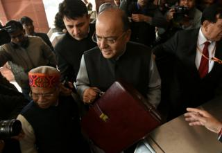 Indian finance minister Arun Jaitley arrives at Parliament House to present the budget