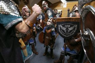 Members of the Jarl Squad get dressed in their Viking suits.