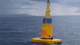 Yellow buoy at sea