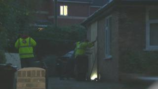 Workers were seen boarding up a section of the house