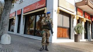 An Italian soldier patrols outside a Kosher restaurant