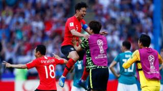 South Korea striker Son Heung-min (CL) celebrates his goal at the 2018 Russia World Cup