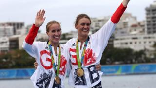 Helen Glover and Heather Stanning with gold medals