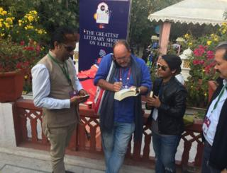 William Dalrymple signing a book