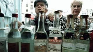 Russians queuing to buy vodka from a street kiosk in Moscow