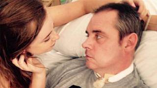 Simon Dobbin in hospital, pictured with his daughter Emily.