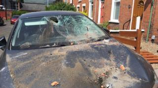 A number of cars were damaged by masonry and slates during an incident in Ashley Drive in south Belfast