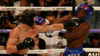 Logan Paul and KSI during their boxing match at Manchester Arena