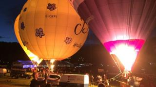 Three balloons lit up