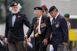 Hong Kong veterans walk after laying wreaths in front of the Cenotaph in Hong Kong, China,