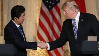 President Donald Trump and Japanese Prime Minister Shinzo Abe shake hands at a news conference at Mar-a-Lago on April 18, 2018