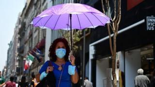 A tourist wears a face mask due to air pollution in Mexico City on 14 May, 2019.
