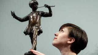 Decorative Arts Specialist Hannah Willetts with the sculpture
