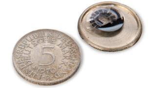 Moneda para esconder microfilmes