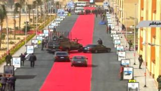 Egyptian presidential motorcade drives down red carpet in 6 October City on 6 February 2016