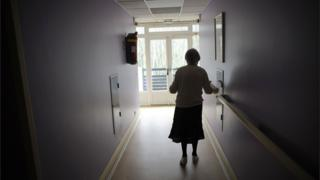 A woman, suffering from Alzheimer's disease walks in a corridor in a retirement house in Angervilliers, eastern France (2011 file picture)