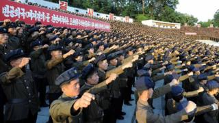 """This picture taken on August 11, 2017 and released by North Korea""""s official Korean Central News Agency (KCNA) on August 12, 2017 shows North Korean youths and workers and trade union members holding a rally to protest the UN Security Council""""s """"sanctions resolution"""" at the Youth Park Open-Air theatre in Pyongyang."""