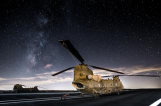 Two Chinooks sit on the flight line at Twenty Nine Palms US Marine Corps base in California US.