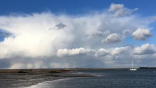 Large cloud over water