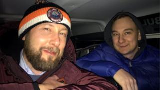 Jarek Grudowski and Piotr Bukolt in rescue vehicle