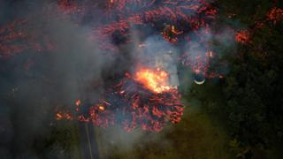 """Lava consumes a home, as volcanic activity continues on Kilauea""""s east rift zone, within the Leilani Estates subdivision, near Pahoa, Hawaii, USA, 06 May 2018."""