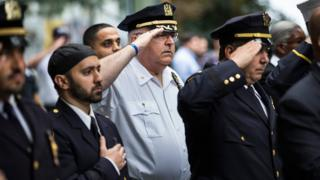 Members of law enforcement salute