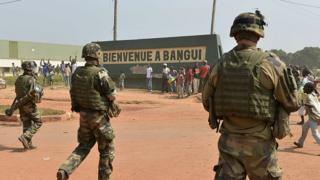 French soldiers patrol in the streets of the Combattant neighborhood in Bangui on December 20, 2013, as part of operation Sangaris.