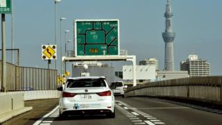 Japan's auto giant Toyota demonstrates autonomous driving with a Lexus GS450h on the Tokyo metropolitan highway during Toyota's advanced technology presentation in Tokyo on October 6, 2015