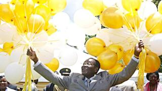 Zimbabwe's veteran leader Robert Mugabe holds 83 balloons in front of relatives and friends at his official residence in Harare, Zimbabwe - 21 February 2007