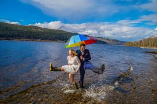 Newly weds in wellies in Loch Ness