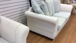 Flood damaged sofas at Trussell Trust charity shop on Wimborne Road