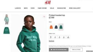 Screengrab of H&M's website showing a child wearing the hoodie with 'coolest monkey in the jungle'on it