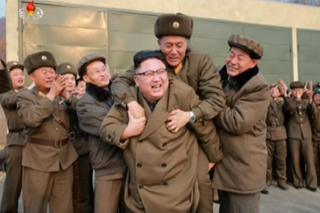 Picture of Kim Jong-un piggybacking a military officer in a photo released on 19 March 2017